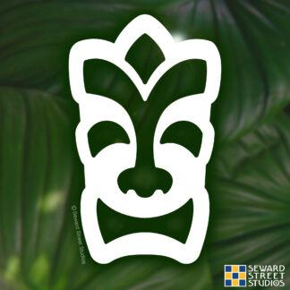 1291 Seward Street Studios Happy Tiki Head vinyl decal shown on a leaves background