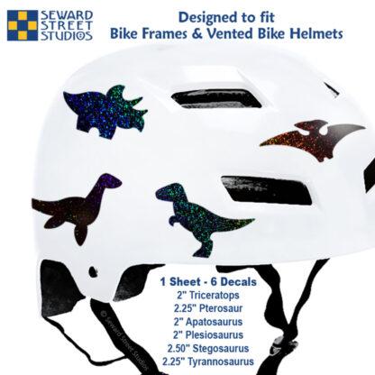 886 Seward Street Studios holographic glitter black dinosaur decal set shown on a white helmet with sizes