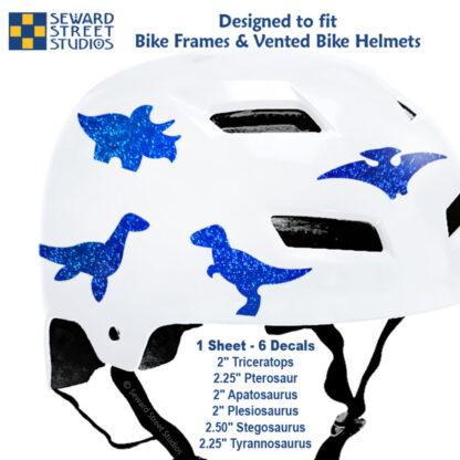 886 Seward Street Studios holographic glitter blue dinosaur decal set shown on a white helmet with sizes