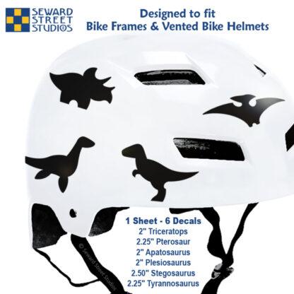 886 Seward Street Studios black dinosaur decal set shown on a white bike helmet with sizes
