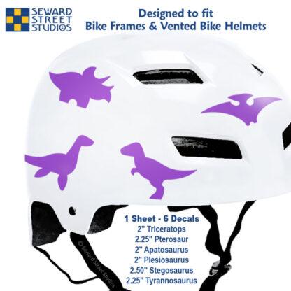 886 Seward Street Studios magenta dinosaur decal set shown on a white bike helmet with sizes