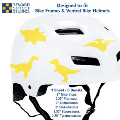 886 Seward Street Studios yellow dinosaur decal set shown on a white bike helmet with sizes